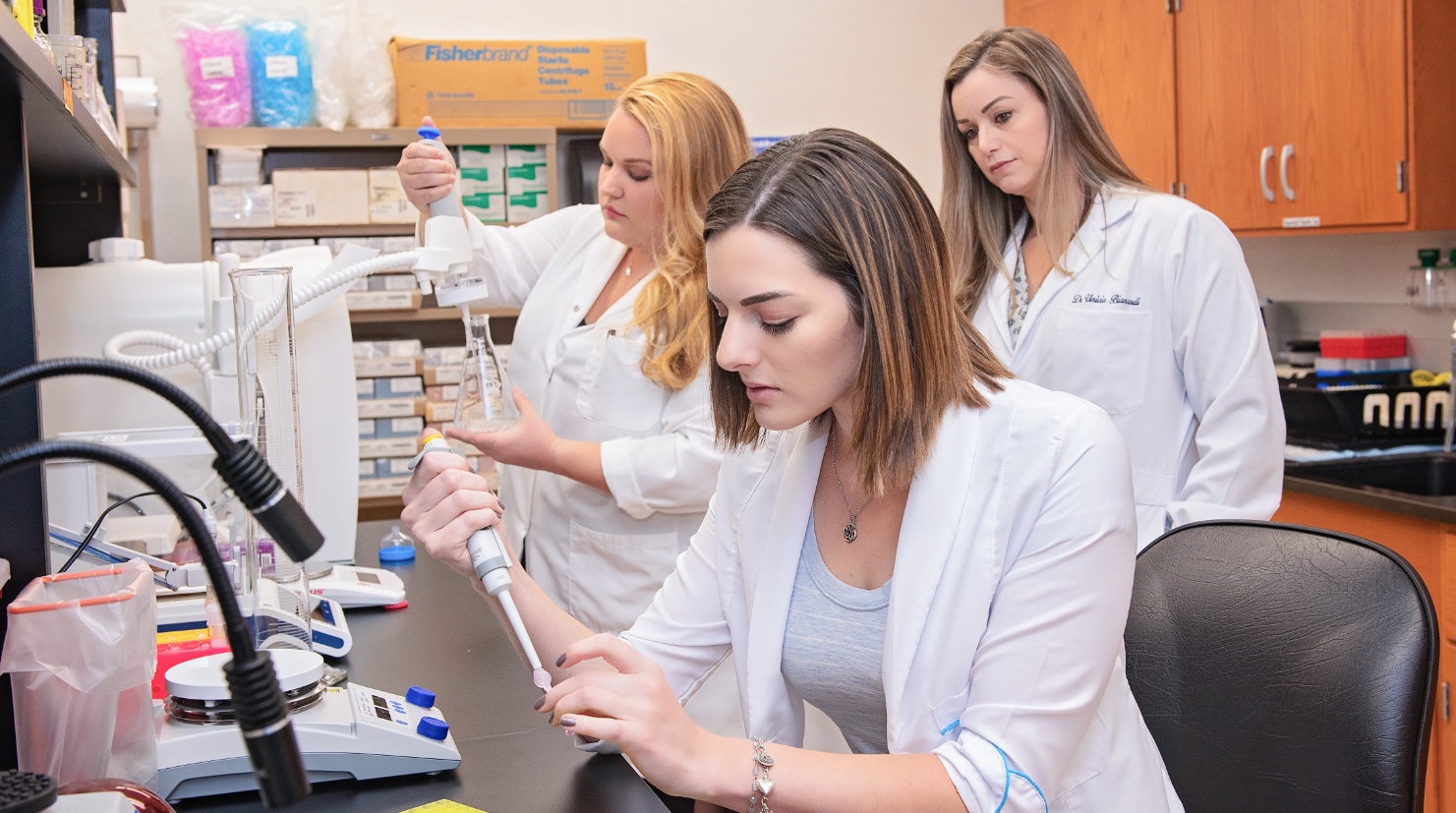 (Left to Right) Sarah Padean, Francesca Mowry, and Dr. Vinicia Biancardi in the lab.