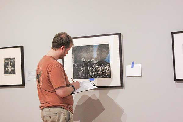Student looking at art on wall