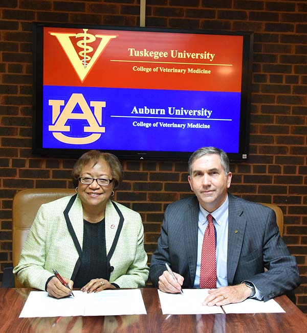 Dean Perry and Dean Johnson signing document