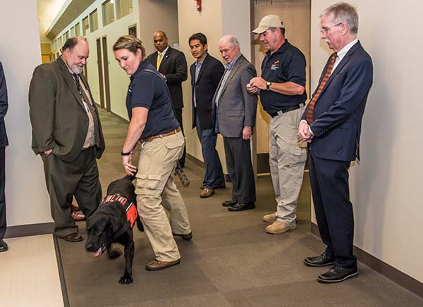 U.S. Attorney Jeff Sessions, center right, watches a demonstration of a detection dog Laura Reeder.