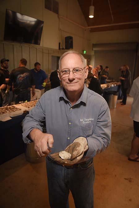 Duke holding open oyster